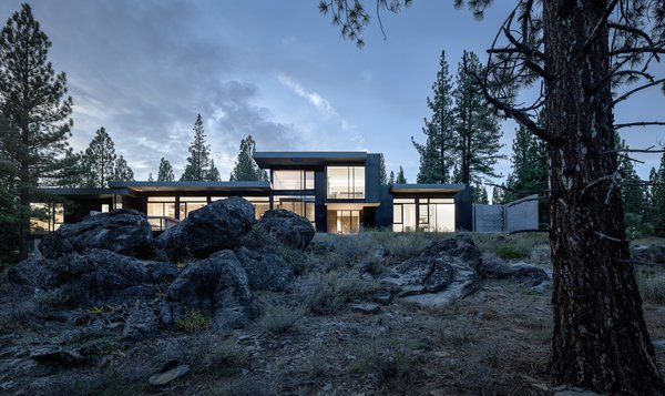 This Concrete Abode Stretches Over Giant Boulders
