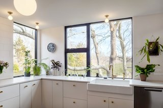 The kitchen offers plenty of storage and windows which offer plenty of natural light.