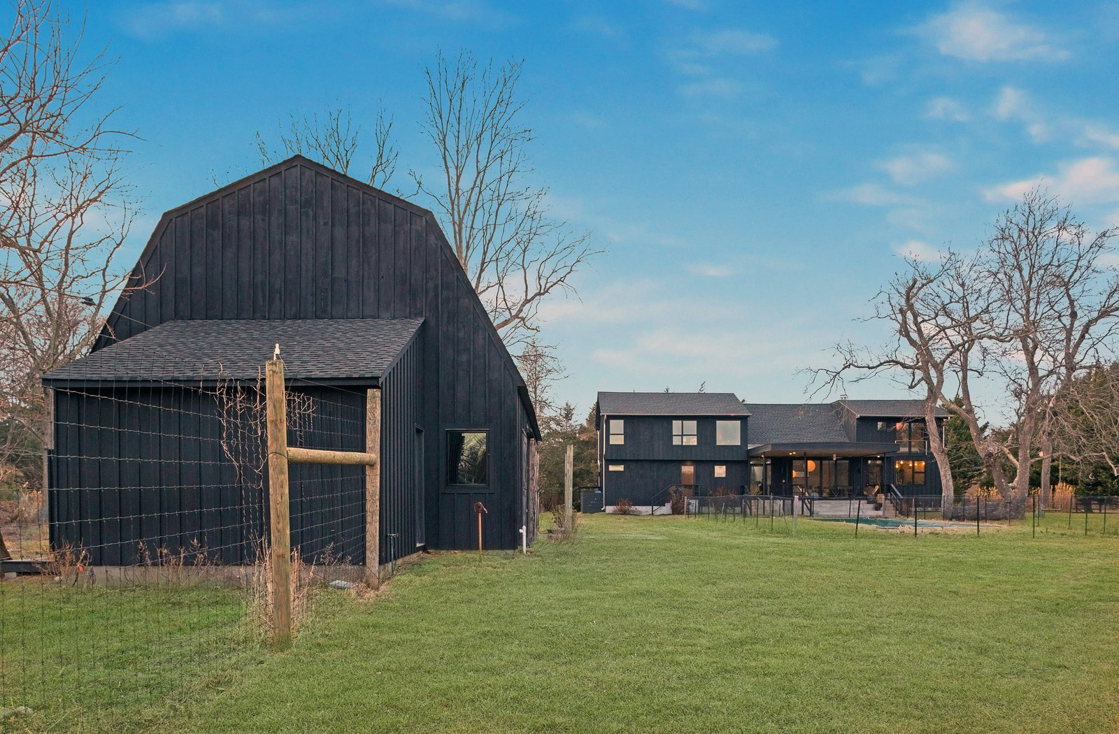 Exterior, Farmhouse, Shingles, Barn, Wood, and Gambrel An  Best Exterior Wood Farmhouse Photos from A Renovated Farmhouse in the Hamptons Hits the Market at $2.8M