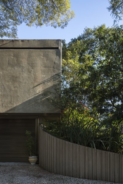 A hovering, monolithic concrete volume forms the bedroom wing and covers the carport. The rear of this volume is the only portion of the home that is visible from the street.
