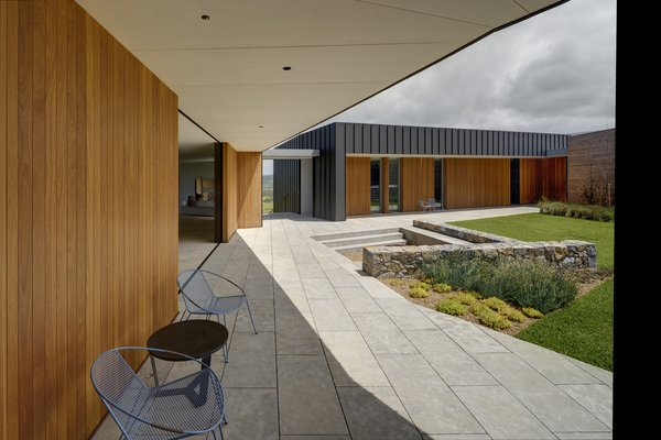 Theliving and dining areas open to the central courtyard, allowing easy indoor/outdoor access.