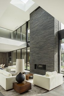 The space is anchored by the brick-inlay, indoor/outdoor fireplace.