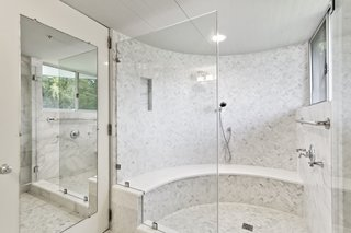 The master bath features a large, enclosed shower.