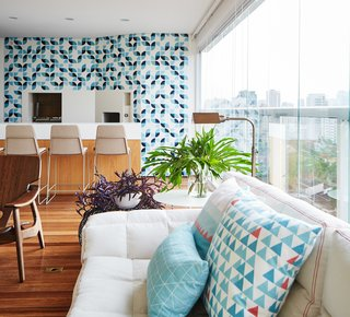 Also adorned with bright colorful tiles, the enclosed terrace now features a bar and a relaxing den-like nook that can be partitioned off with curtains.