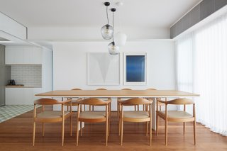 The firm created custom furniture for the home's renovation, including this dining table.