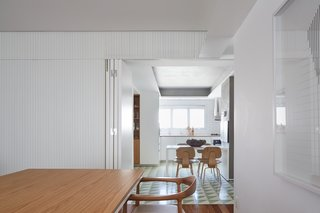 A hinged door can conceal the kitchen to create a more formal dining space.