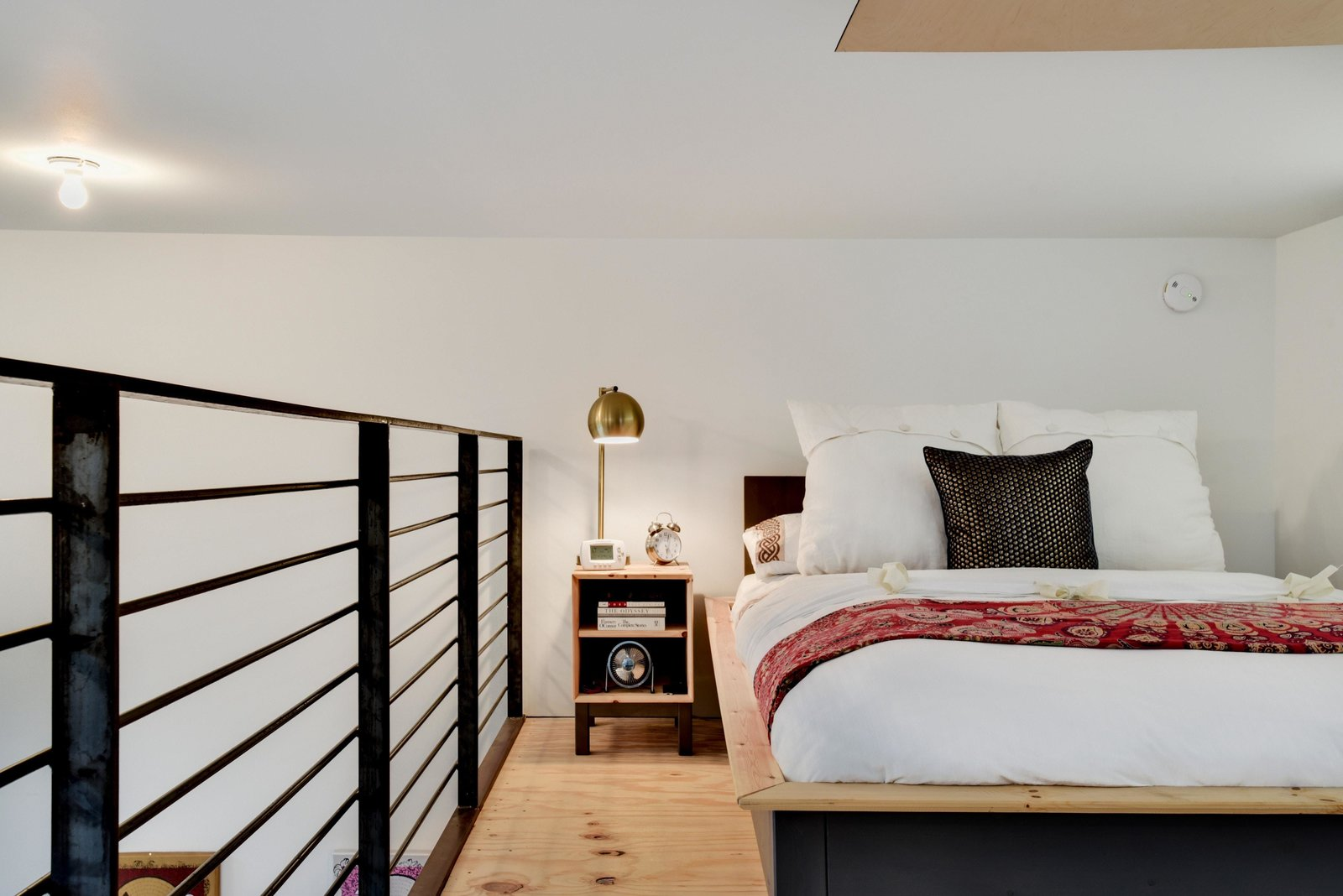 Bedroom, Bed, Night Stands, Medium Hardwood Floor, Table Lighting, and Ceiling Lighting T  Photo 16 of 22 in Own This Alluring Sculptural Abode in Austin For $3.1M