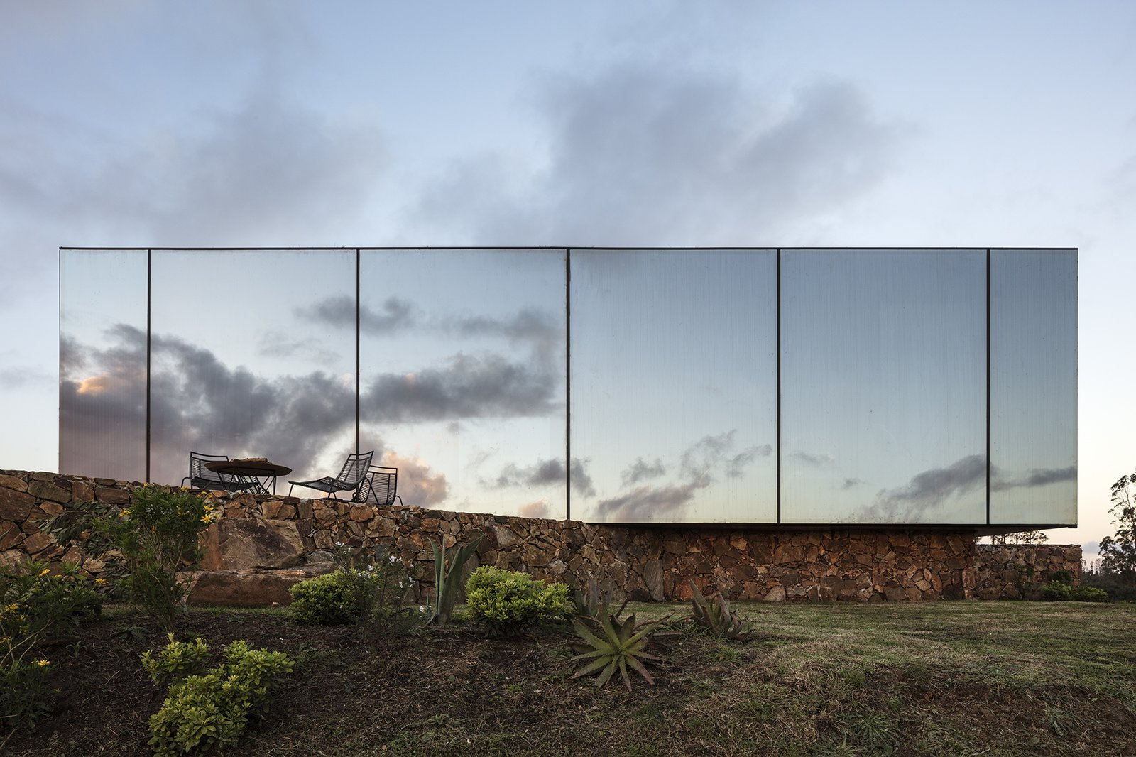 Exterior, Flat RoofLine, Prefab Building Type, Glass Siding Material, and Cabin Building Type  Best Photos from A New Prefab Hotel in Uruguay Seems to Melt Into the Landscape