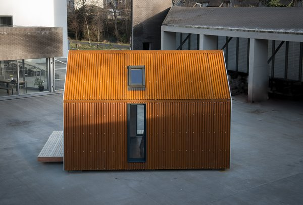 Exterior, Metal Siding Material, Wood Siding Material, Gable RoofLine, Prefab Building Type, Metal Roof Material, and Cabin Building Type The Bothy's clean outline conceals a drainage system and 10cm of wood-fiber insulation.  Photo 4 of 12 in Go Off-Grid in This Prefabricated Cor-Ten Steel Cabin