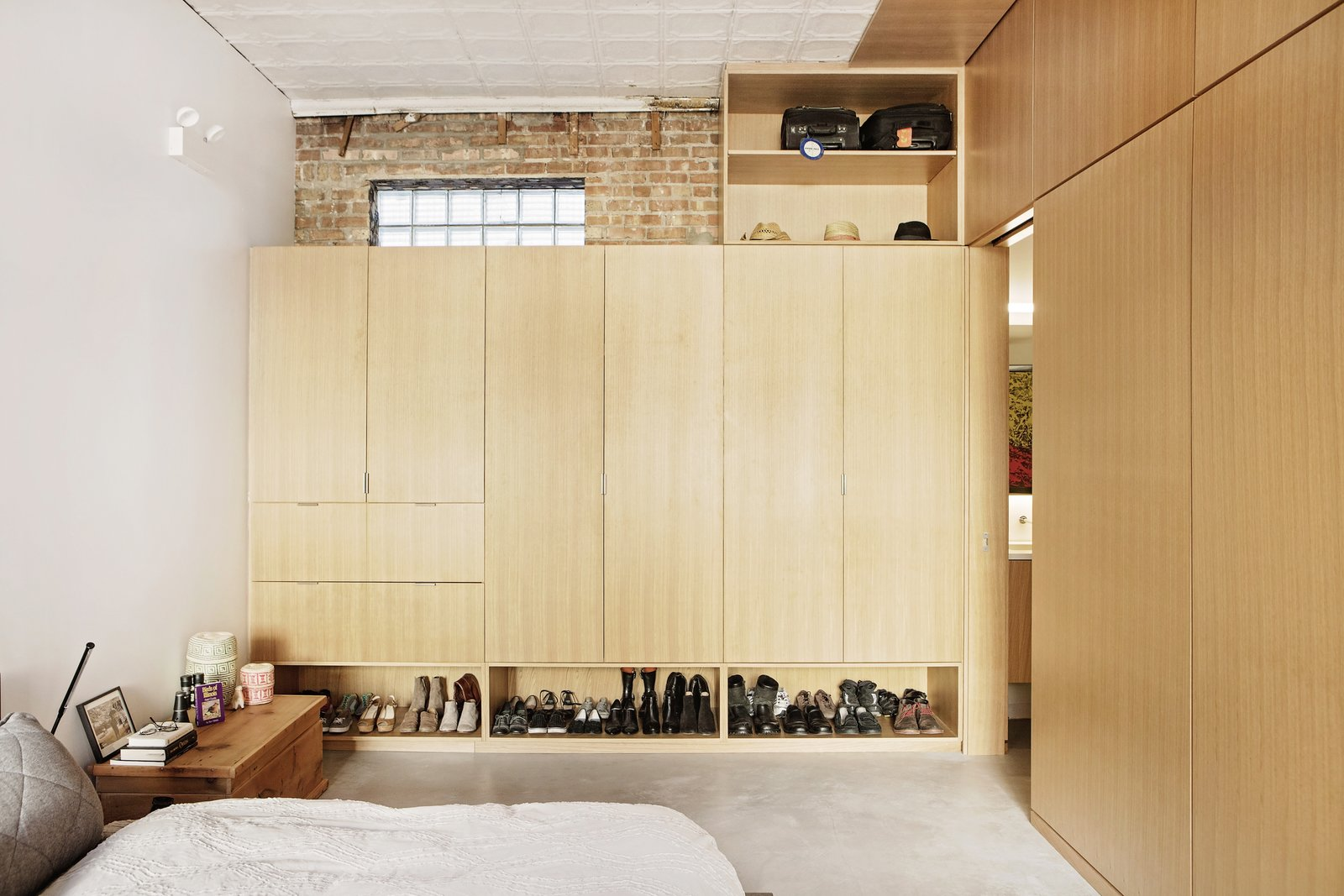 Bedroom, Wardrobe, Bed, Concrete, Storage, Night Stands, and Wall T  Bedroom Bed Concrete Wardrobe Photos from Before & After: A Rundown Bodega in Chicago Is Reimagined Into a Vibrant Live/Work Space