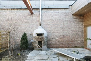 The base of the pizza oven is constructed from bricks that were salvaged during the demolition.