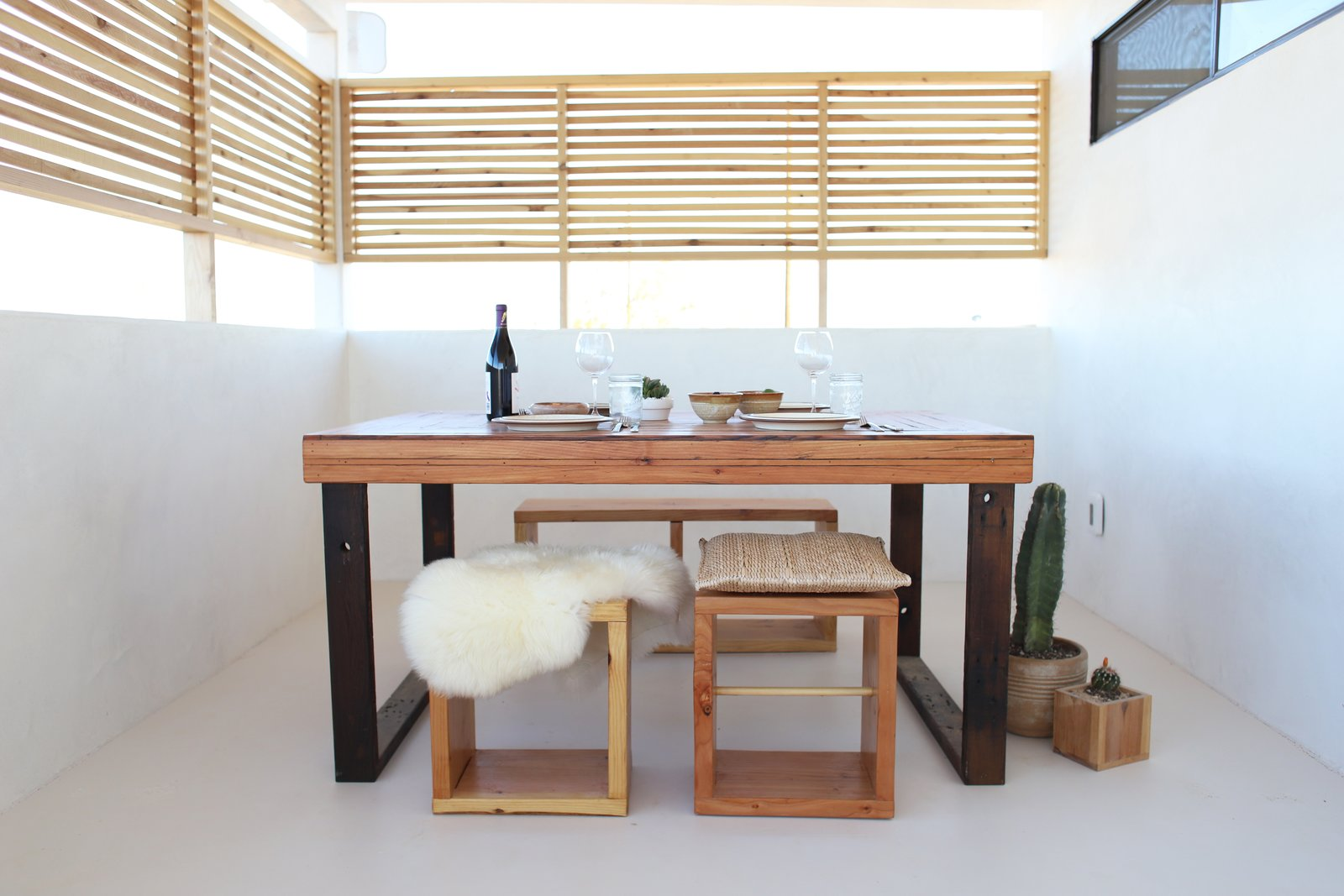 A porch enclosed with a screen to increase light and air-flow became a dining area.