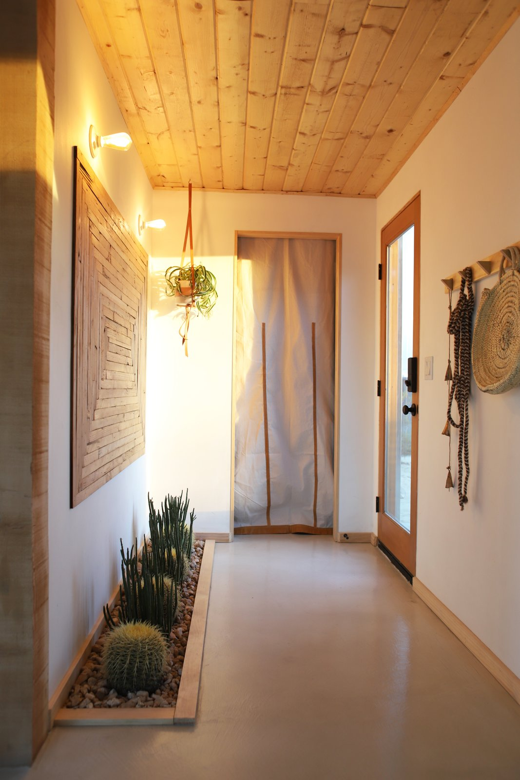 The entrance to the home, a curtain blocks.....