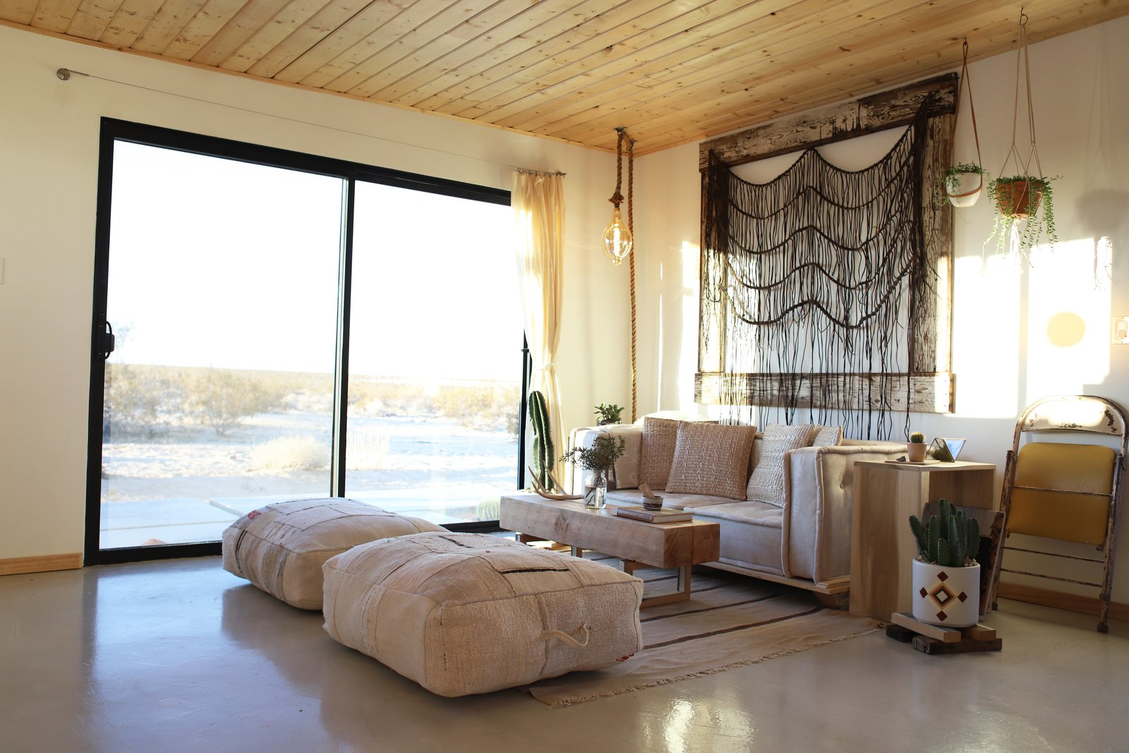 The macrame by xxx hangs in the living room and sliding glass doors were added to help integrate the home to the outdoors. The abundant desert sunshine makes natural lighting a viable option all day long.