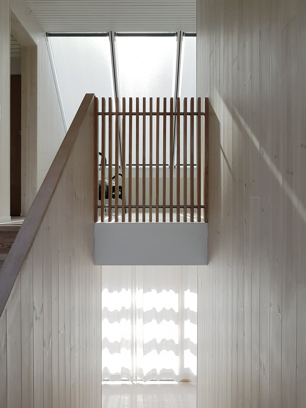 Large windows and skylights provide ample natural light which is reflected off the larch interiors and white ceilings.