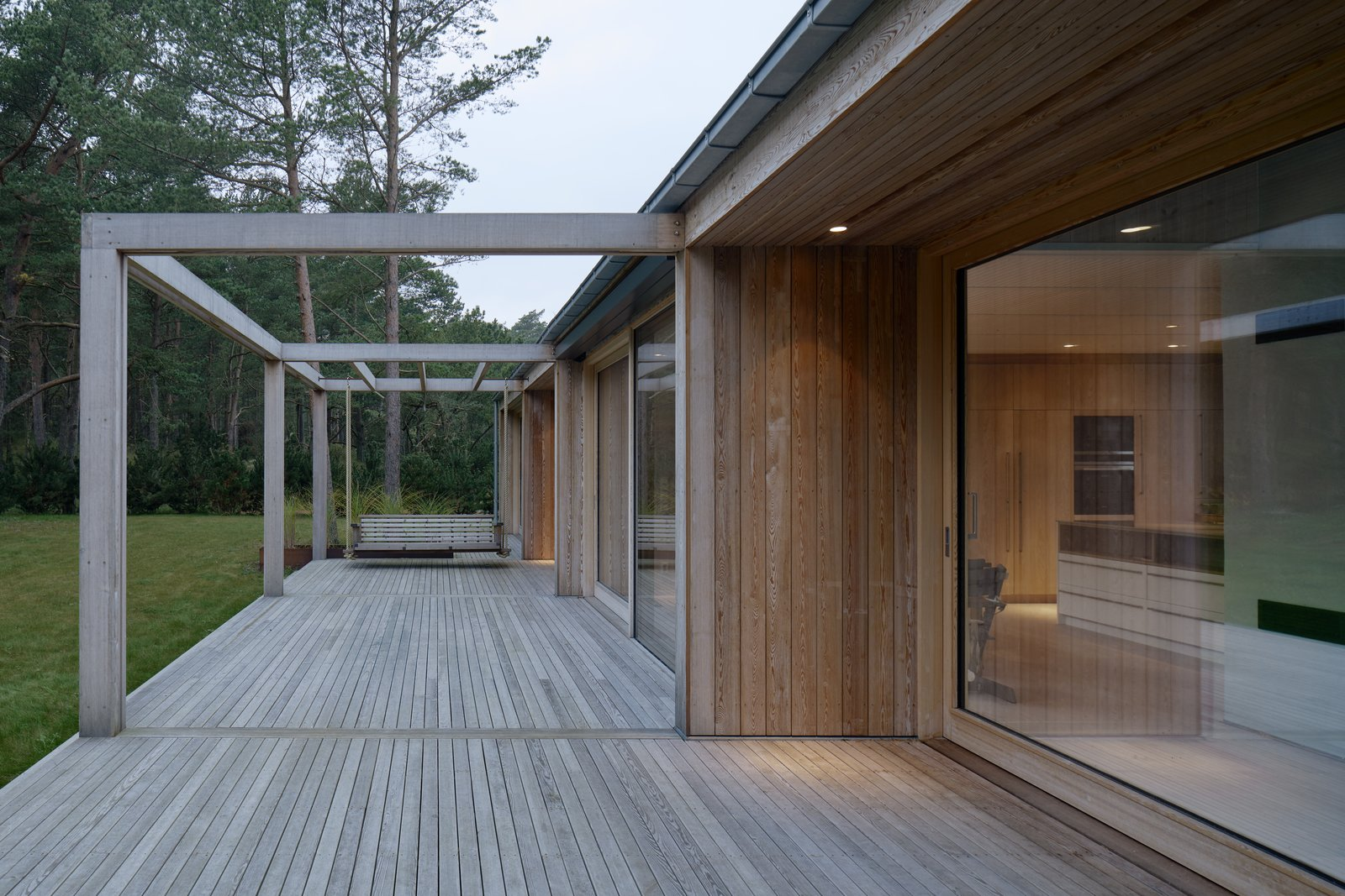 The deck and pergola appear to be a natural extension of the home.