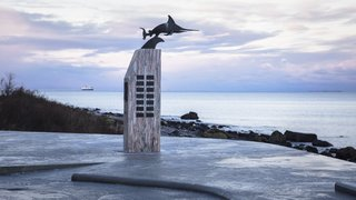 This Concrete Rest Stop Will Make You Want to Visit Norway - Photo 6 of 8 - In addition to the view, the contemplative site is a perfect setting for the WWII memorial that commemorates the 42 crew members who lost their lives when the Uredd submarine sank.