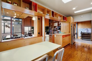 The kitchen has been modernized, and includes plenty of well-designed storage space.