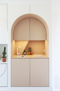 "This Tiny Home in Paris Unfolds Like a Children's Pop-Up Book - Photo 8 of 11 - A peek at the delightful ""kitchenette."""