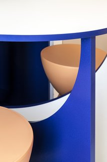 A detail of the brilliantly colored table and stools.
