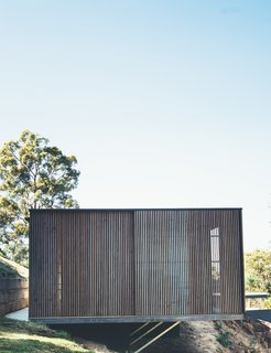 The home is cantilevered out over the hillside site.