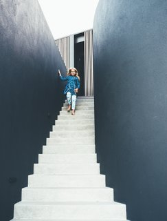First and foremost, the home was designed to be a comfortable family home. The kid's bedrooms open directly to the garden spaces to make it easy for them to go outside and play.