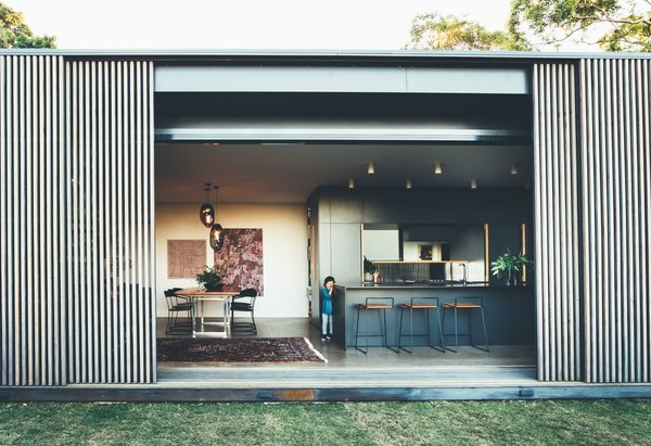 This Australian Abode Is a Glass Pavilion Wrapped in Sliding Hardwood Screens
