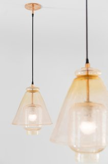 The kitchen lights were designed by August and custom-made by a local glass blower.