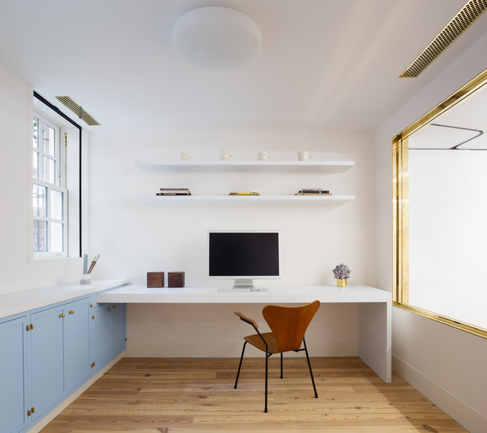 The cellar now houses an office, studio, and exhibition space.