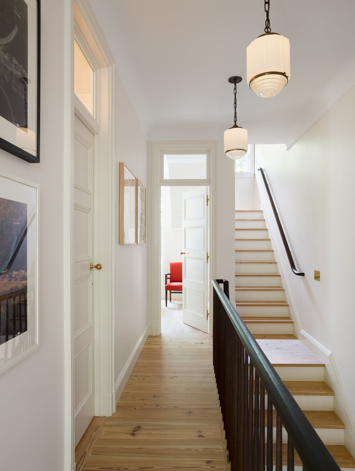 All of the doors in the hallway were salvaged and found by the owners. Yun designed and inserted the glass transom windows above the doors.