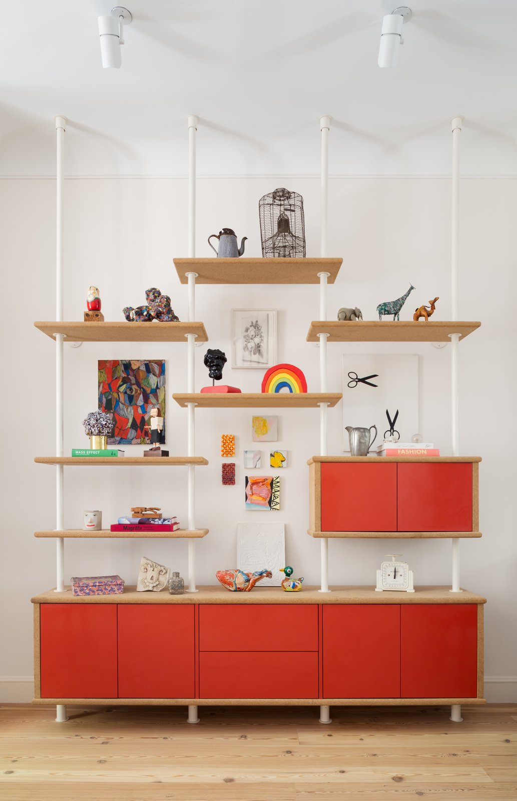 The red wall cabinet was designed by August. The floors throughout the home were replaced with wide, salvaged heart pine floorboards with radiant heat.