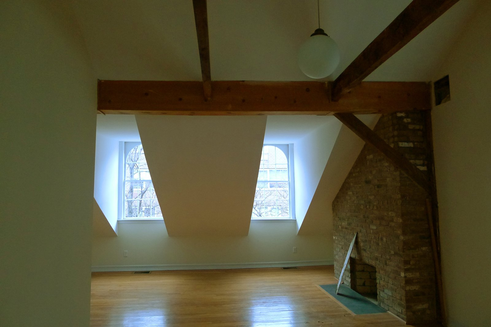 The top floor before the renovation felt cramped, and held another defunct fireplace in need of restoration.