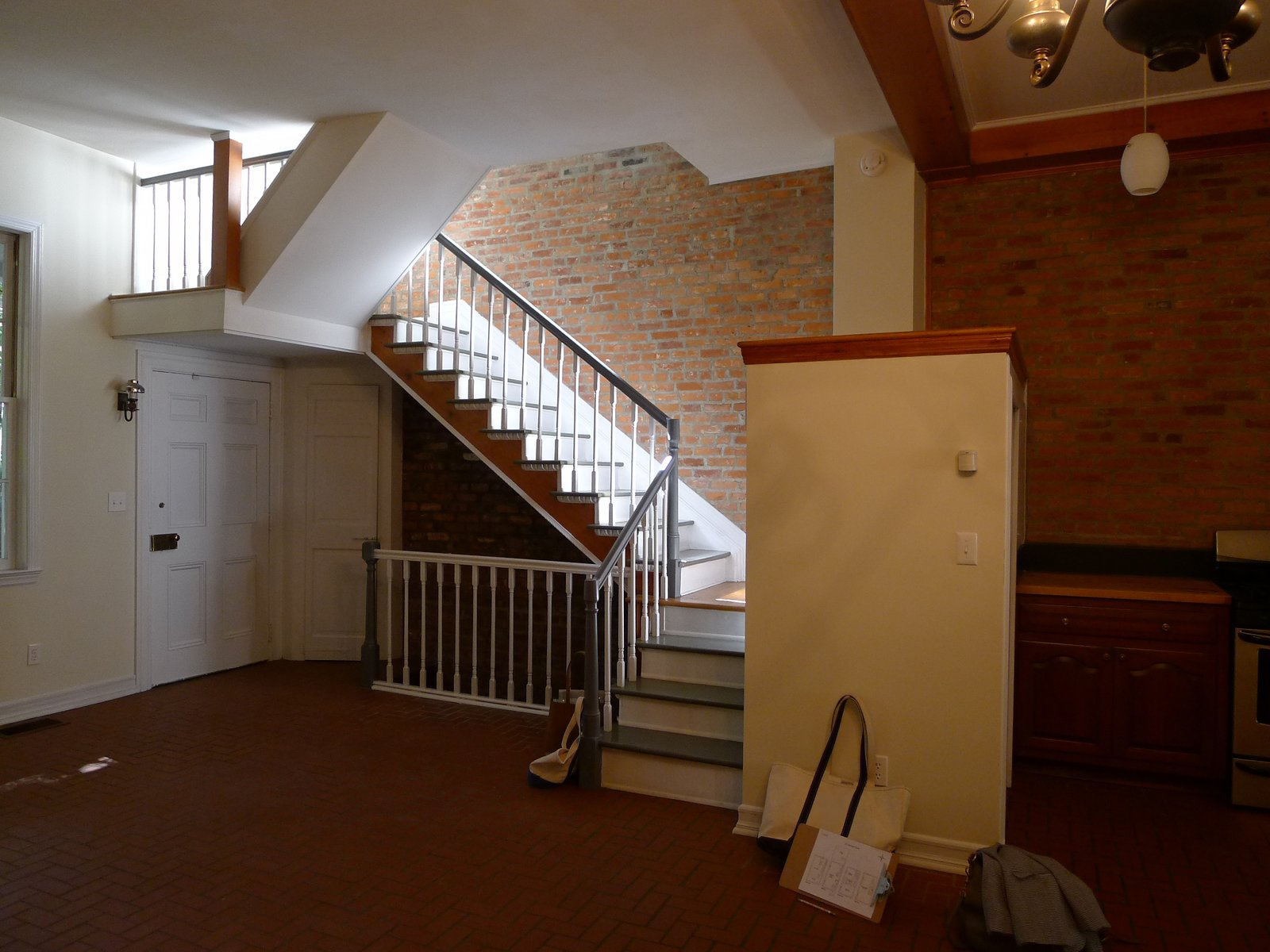 The biggest architectural maneuver in the renovation was moving the staircase to allow for a more spacious kitchen. In this view, you can see the little volume at the center that housed the refrigerator.