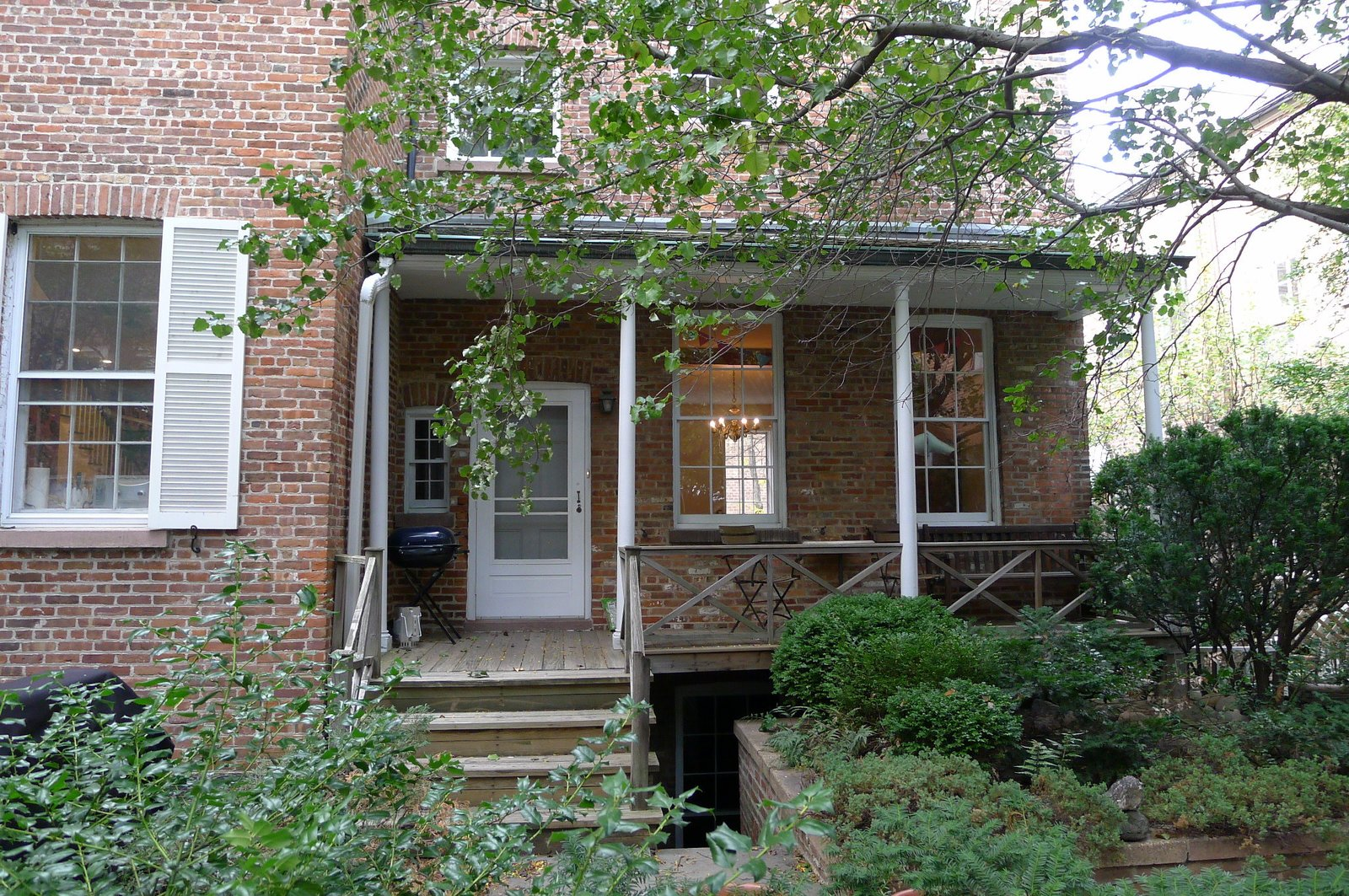 The wooden porch in the rear yard was deemed illegal during the Department of Buildings process. Wood is not allowed, and it had to be remade with non-combustible materials.