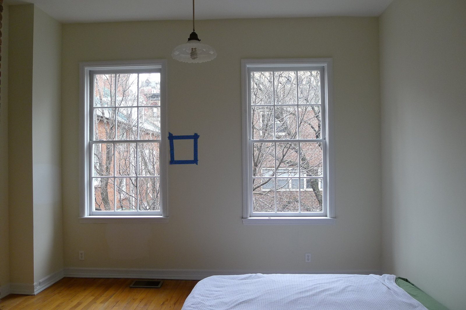A second upstairs bedroom with a defunct brick fireplace would become an office.