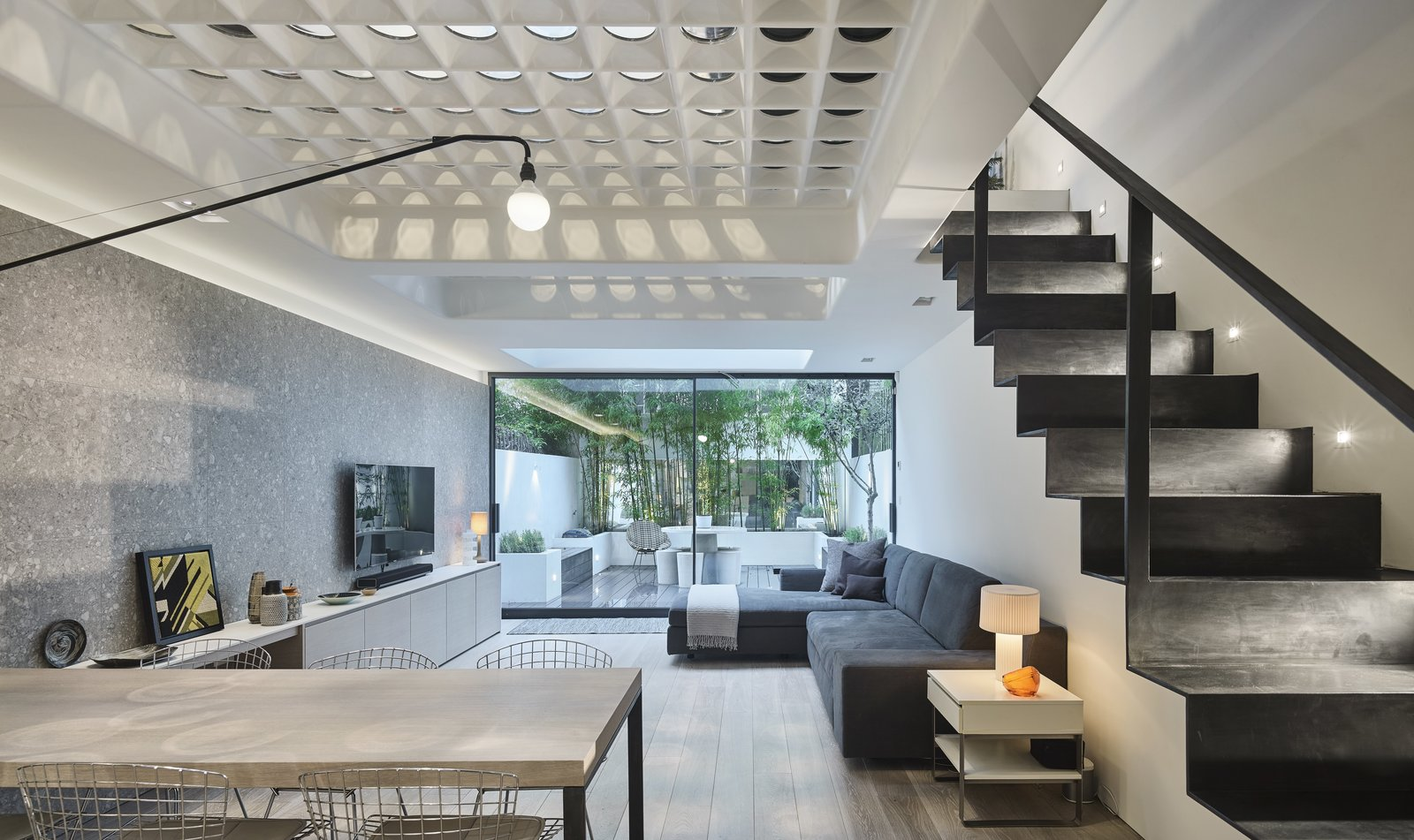 A London Townhouse Has Glass Circles in Its Floors to Filter in Ample Natural Light & A London Townhouse Has Glass Circles in Its Floors to Filter in ...