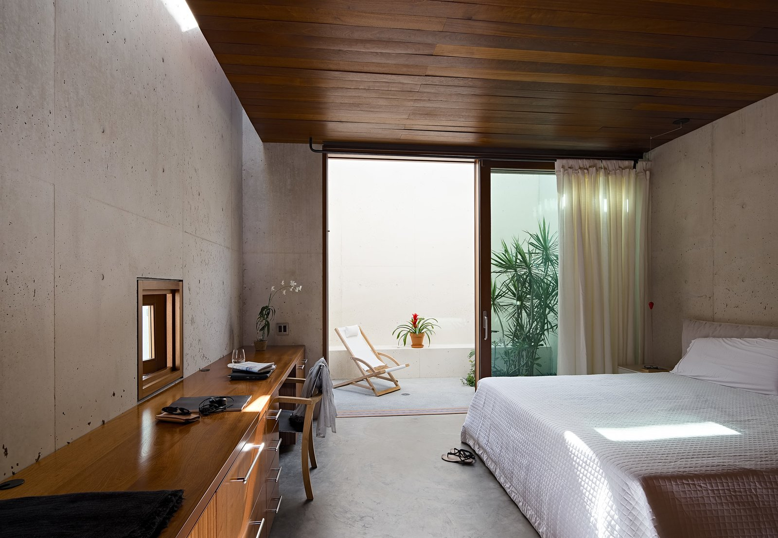 Even the bedrooms integrate the outdoor spaces into the design.