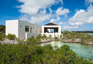 For Le Cabanon, a house in the Turks and Caicos islands north of the Dominican Republic, Joy took stock of the materials of the island—sand, rock and water—and created walls of brilliant white concrete.