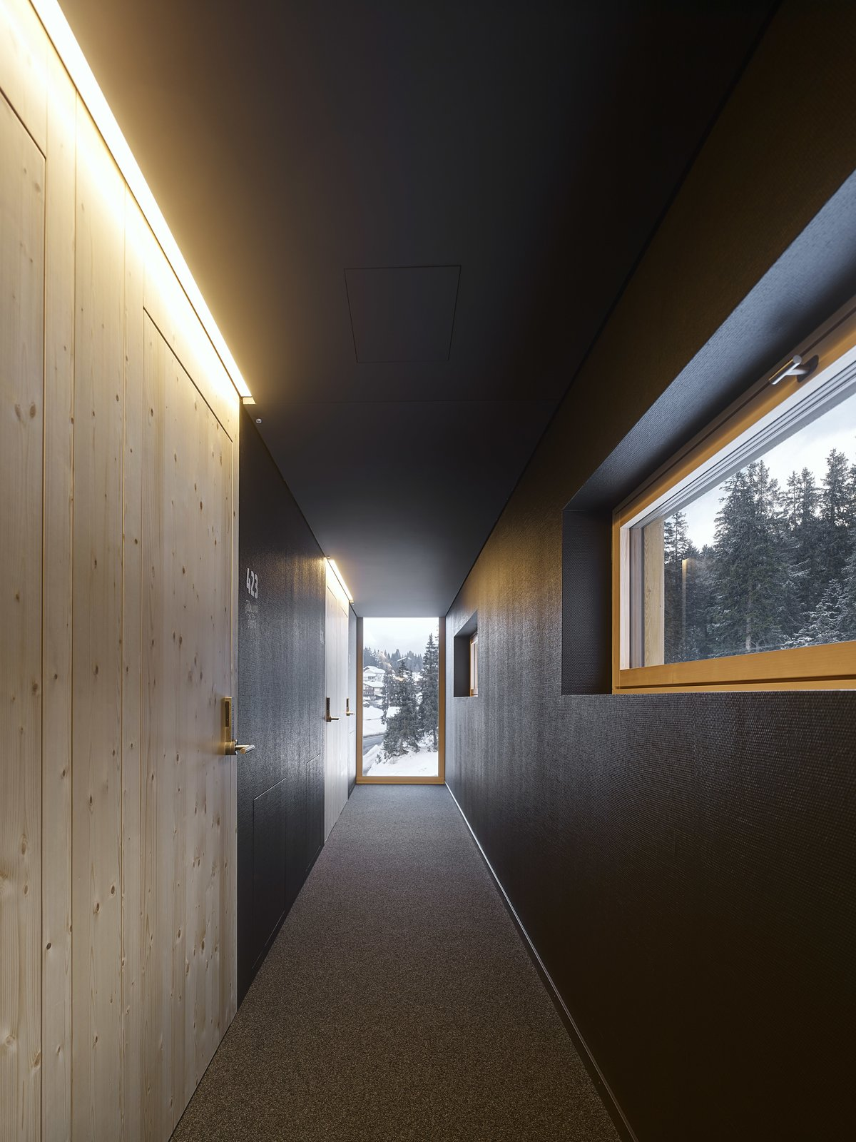 A long corridor provides access to the individual rooms.