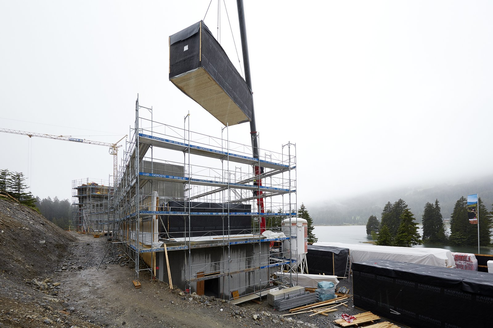 A room module being lowered into place.