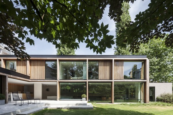 The ground floor follows an L-shaped plan and is accessed from the garden via a concrete terrace.