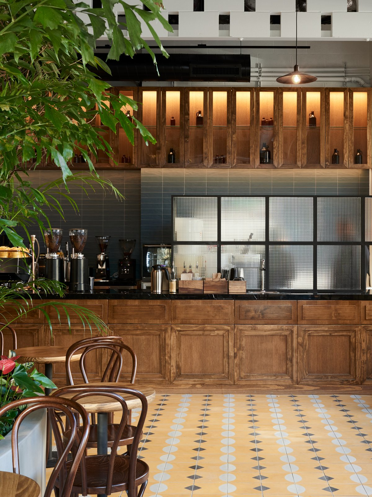 """Additional elements found inDevoción's newest location include a 26-foot wood bar that displays the cafe's """"Ground Control"""" drip machine, a custom Slayer espresso machine and Espresso Grinders from Ceado E37k that boast the slowest RPM on the market, a feature that prevents overheating."""