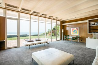 Floor-to-ceiling glazing provides breathtaking views of the ocean, and brings in plentyof natural light throughout the home.