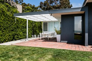Acovered terrace adds to the home's potential to enjoy indoor/outdoor living.