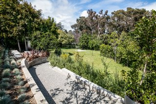The half-an-acre lot offers a unique opportunity to own a Case Study House and build a new separate modern domicile, or potentially divide the lot.