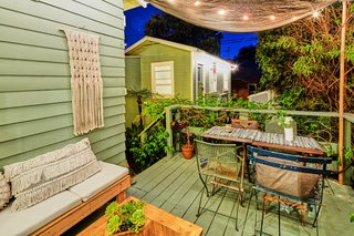 The outdoor space is perfect for indoor/outdoor entertaining. It also overlooks the guesthouse.