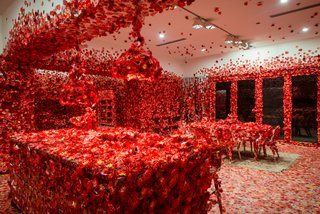 "The installation revisits the origins of Kusama's art, which she traces back to her childhood. ""One day, after gazing at a pattern of red flowers on the tablecloth, I looked up to see that the ceiling, the windows, and the columns seemed to be plastered with the same red floral pattern. I saw the entire room, my entire body, and the entire universe covered with red flowers, and in that instant, my soul was obliterated … this was not an illusion, but reality itself,"" the artist explains in a press statement."