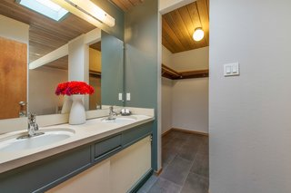 The master bedroom also has an en-suite bathroom and features a large walk-in closet.