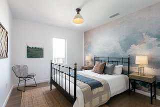One of the three bedrooms features mural-type wallpaper from Anewall.