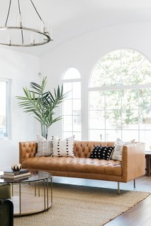 The large arched windows allow ample natural light to flood the interiors.